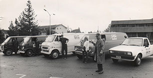 Employees of the Furnace Man standing in front of their service vans in 1980.